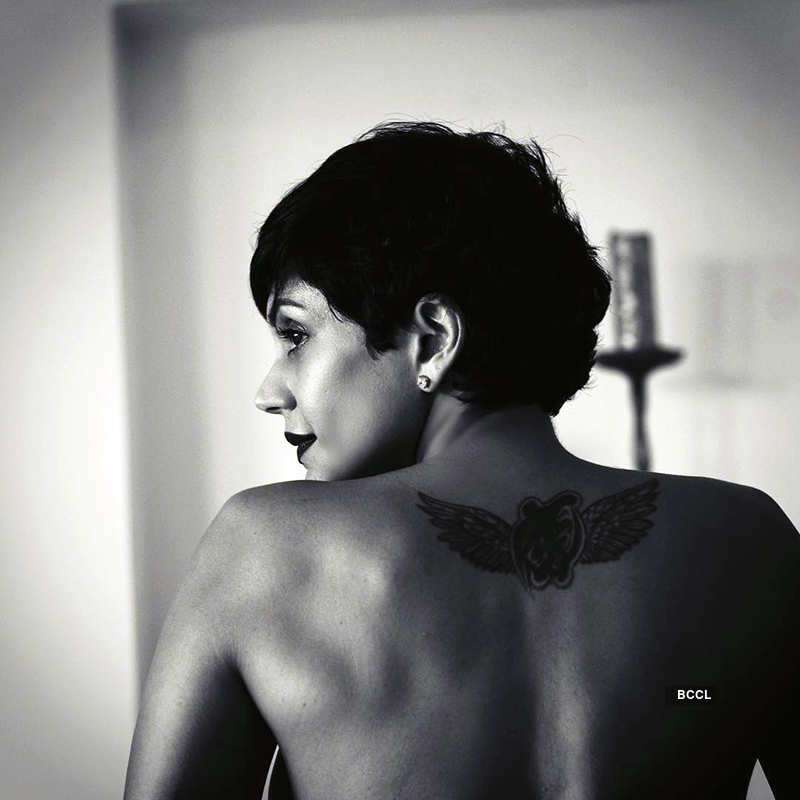 Mandira goes topless, shows off her tattoo