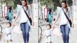 Baby Misha and mommy Mira Rajput go hand-in-hand for an evening stroll