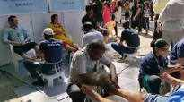 Visitors enjoy foot massage by visually impaired students at Kala Ghoda Arts Festival
